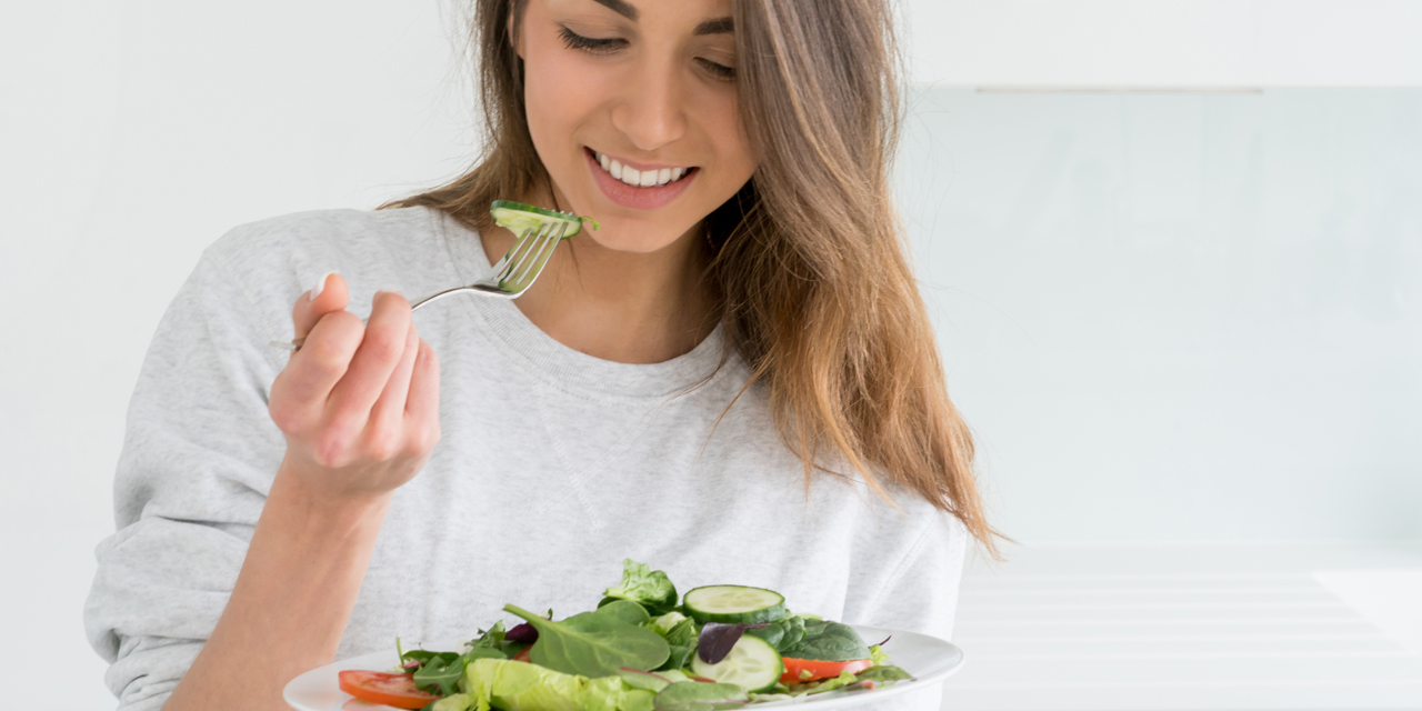 pic of lady eating a salad
