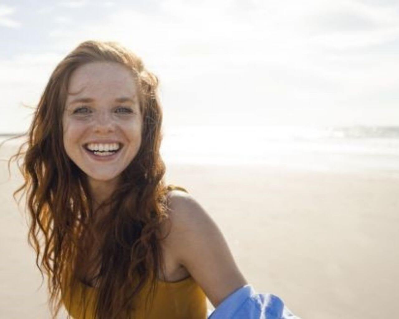 pic of a smiling girl on a beach