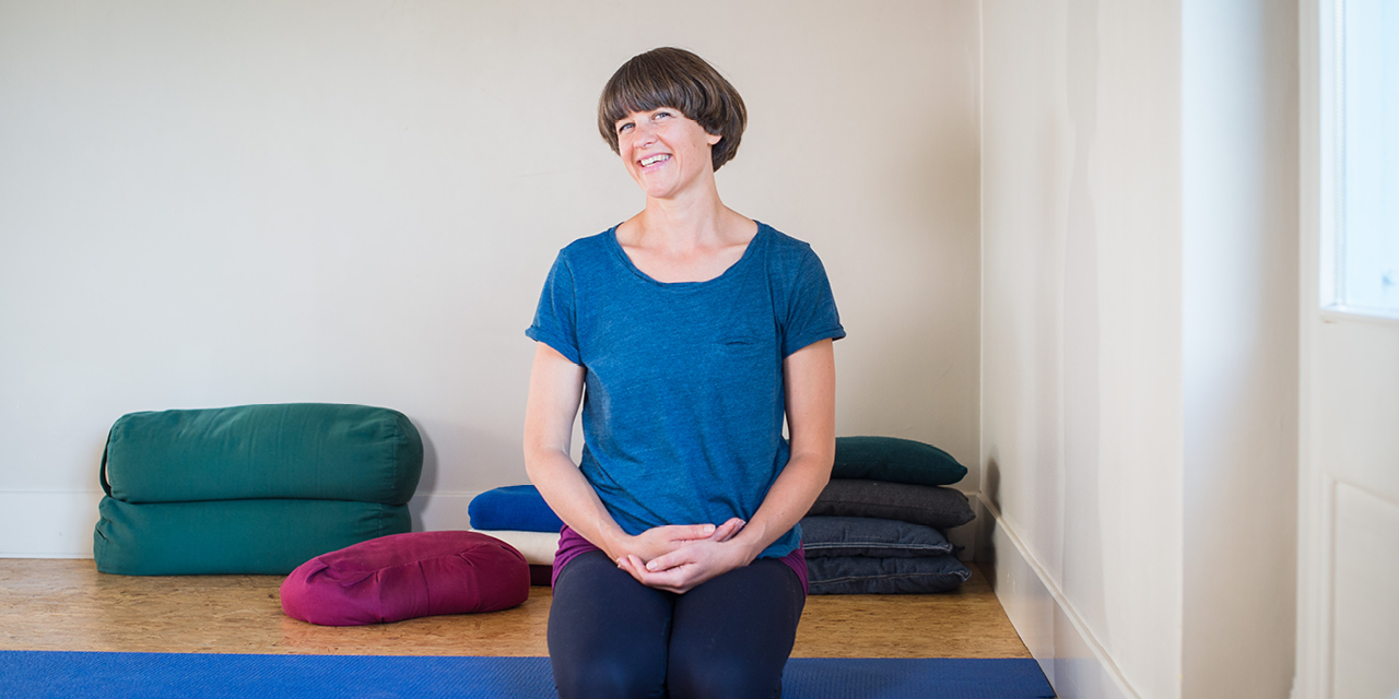 Jessica Hatchett in a blue top, with her hands clasped